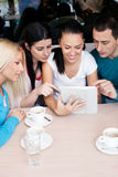 Group of teenagers using tablet touch. At cafe Stock Images