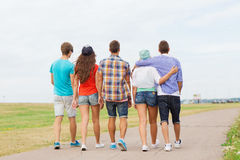 Group of teenagers walking outdoors from back Royalty Free Stock Photo