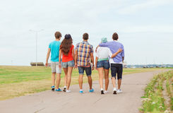 Group of teenagers walking outdoors from back Royalty Free Stock Photography
