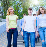 Group of teenagers walking outdoors. Smiling group of teenagers walking outdoors Royalty Free Stock Photography