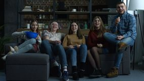 Group of teenagers watch comdey movie with popcorn stock video