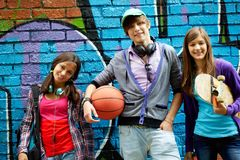 Group of teens. Row of happy teens by painted wall looking at camera Stock Photography