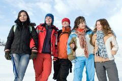 Group of  teens different ethnicity. Group of sport teens different ethnicity winter outdors at mountain Tien Shan. One boy and four girls Royalty Free Stock Photo