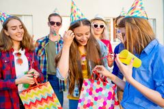 Teens having a party. Group of teens are having a birthday party Stock Photos