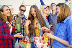 Teens having a party. Group of teens are having a birthday party Royalty Free Stock Photos