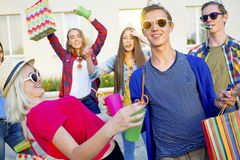 Teens having a party. Group of teens are having a birthday party Stock Image