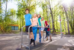 Group of teens holding and hanging on brachiating Royalty Free Stock Photo