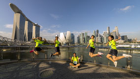 Group of teens jump shot with city skyline background. Stock Images