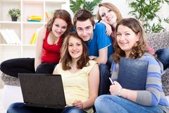Group of teens  with laptop Royalty Free Stock Photos