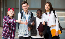 Group of teens posing outside school Stock Photo