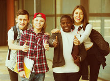 Group of teens posing outside school Royalty Free Stock Photos