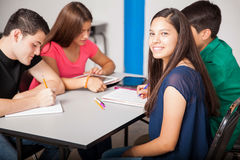 Group of teens studying together. Group of Latin high school students working together in a classroom Stock Images
