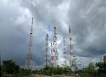Group of telecommunication masts and storm. Stock Photo