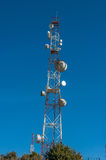 Group of telecommunications towers in Morocco. Group of telecommunications towers with blue sky Stock Image