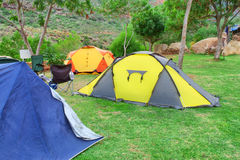 Group of tents on camping site Stock Photo