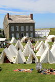 Group of tents and historic buildings set up for reenacting wartime events, Fort Ontario, New York, 2016 Royalty Free Stock Photos