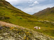 Group of Tents in Mountain Valley, Autumn in Alaska stock photography