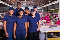 Group textile workers. Group of textile workers in production area Royalty Free Stock Photo