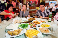 Group of Thai tourist eating Chinese food Royalty Free Stock Photo