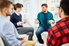Group therapy. Circle of students practicing psychological therapy in group royalty free stock photography