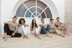 Group therapy session for couples. With trust issues. Talk out your problem. Young married couples happy talking while sitting on the therapy session with stock photography