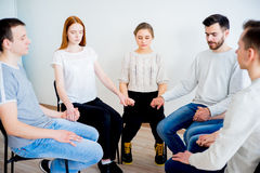 Group therapy in session. People are sitting in circle on a group therapy session stock image