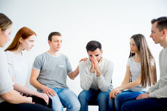 Group therapy in session. People are sitting in circle on a group therapy session stock photography