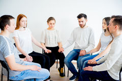 Group therapy in session. People are sitting in circle on a group therapy session stock images