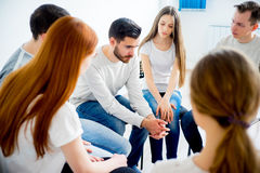 Group therapy in session. People are sitting in circle on a group therapy session royalty free stock images