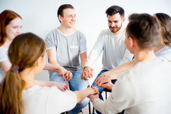 Group therapy in session. People are sitting in circle on a group therapy session stock photos