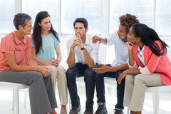 Group therapy in session sitting in a circle. In a bright room Royalty Free Stock Image