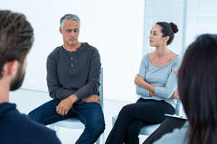 Group therapy in session sitting in a circle. In a bright room royalty free stock images