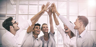 Group therapy in session sitting in a circle high fiving. In a bright room royalty free stock images