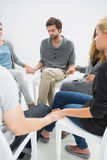 Group therapy in session sitting in a circle Stock Photography