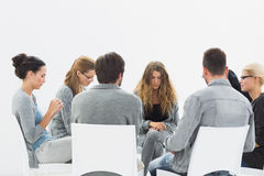 Group therapy in session sitting in a circle Stock Images