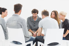 Group therapy in session sitting in a circle Royalty Free Stock Photo