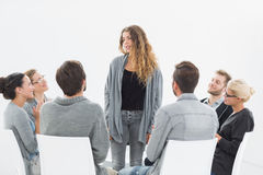 Group therapy in session sitting in a circle Royalty Free Stock Images