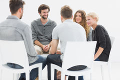 Group therapy in session sitting in a circle. With therapist Royalty Free Stock Photography