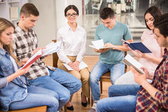 Group therapy. Therapist speaking to a rehab group at therapy session Stock Photos