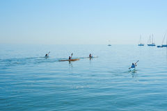 Group therapy training on kayak. Group training of children kayaking in the sea. Concept sports Stock Photography