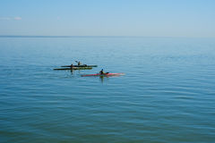 Group therapy training on kayak. Group training of children kayaking in the sea. Concept sports Stock Image