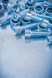 Group of threaded construction nuts and screw Royalty Free Stock Image
