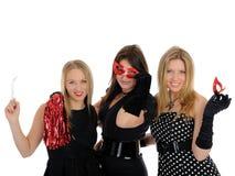 Group of three beautiful elegant woman celebrating Stock Photo