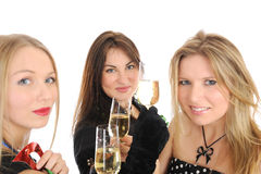 Group of three beautiful elegant woman celebrating Royalty Free Stock Photo