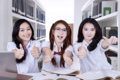 Beautiful high school student showing thumbs up royalty free stock photo