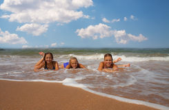 Group of three beautiful teen girl  on the beach. Group of three beautiful teen girl in water on the beach Royalty Free Stock Image
