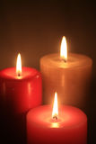 Group of three burning candles Royalty Free Stock Photos