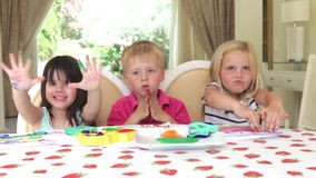 Group of three children sit  stock video footage