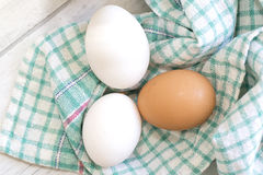 Group of three eggs on colored cloth Royalty Free Stock Image