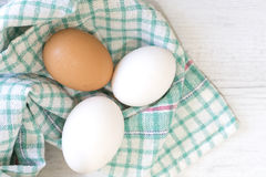 Group of three eggs on colored cloth Royalty Free Stock Images